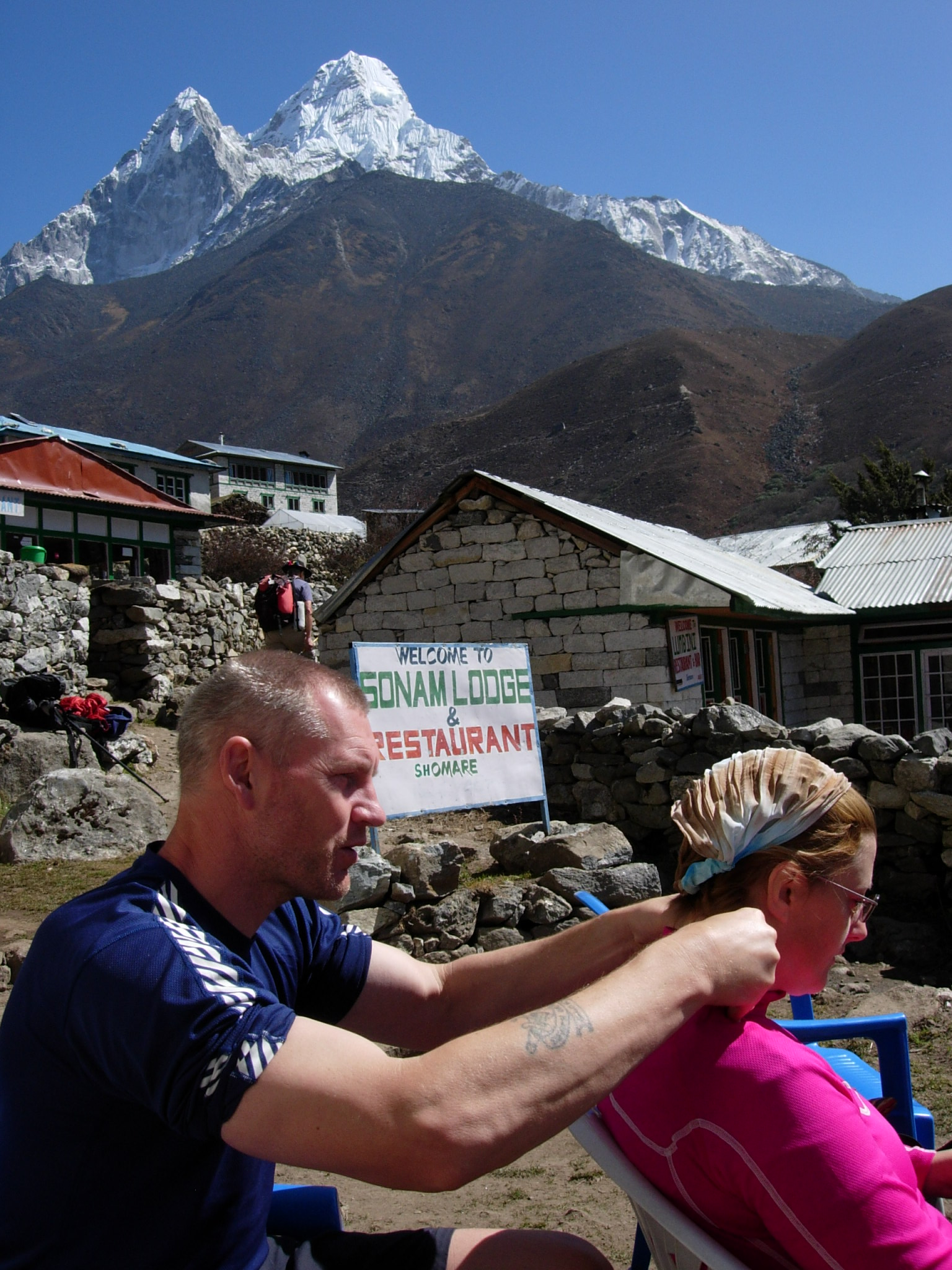 Here we see Steve massaging Marie's neck and shoulders to relieve the muscle tension due to much carrying of rucksacks. The splendid Ama Dablam in the background.
