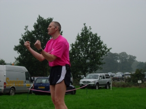 Steve does a warm-up routine for the 100's of people gathered for the 5km and 10km walk in aid of Cancer Research at Shugborough Staffordshire. It is the first time he's appeared in pink by the way.